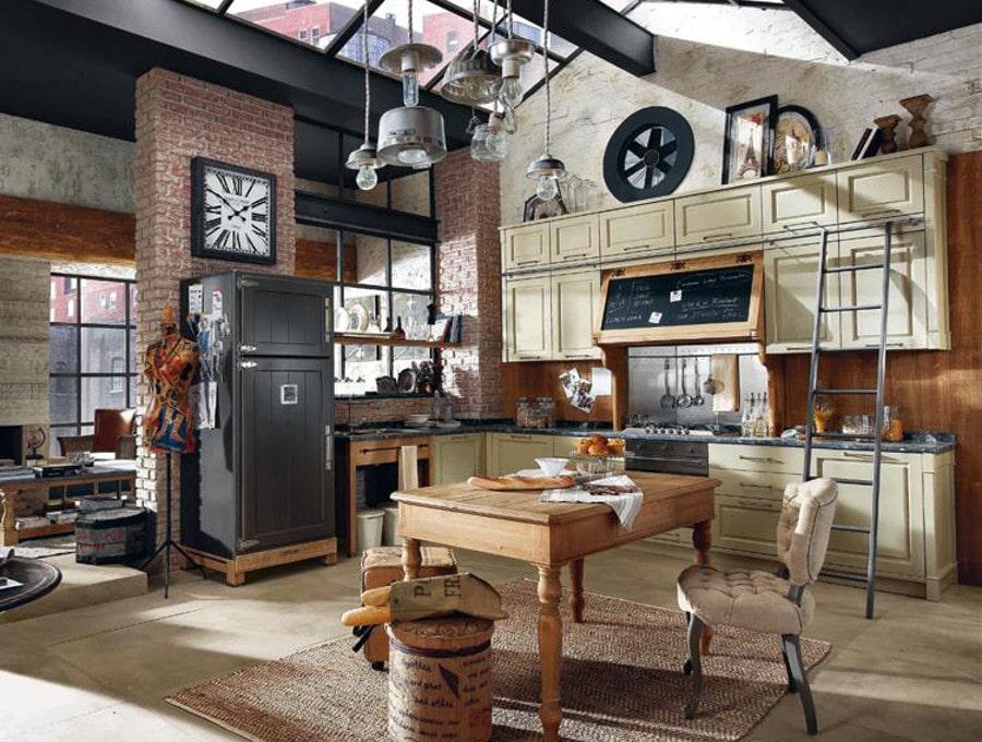 On aime déjà la cuisine vintage en soi mais ici le toit en verrière et l'aménagement style loft mettent la barre un peu plus haut.