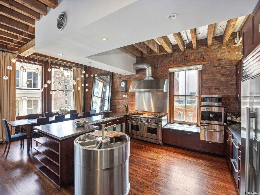 Un exemple de l'association du bois et du métal. On obtient une cuisine de style industriel, au coeur de la tendance actuelle.