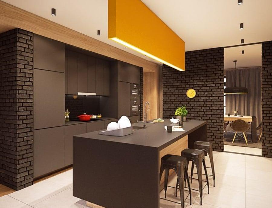 On se sent tout de suite enveloppé dans une ambiance chaleureuse en regardant cette fois. Le choix de la couleur chocolat dans la cuisine est plutôt originale. Mais le résultat est là. On a une jolie cuisine de style loft.